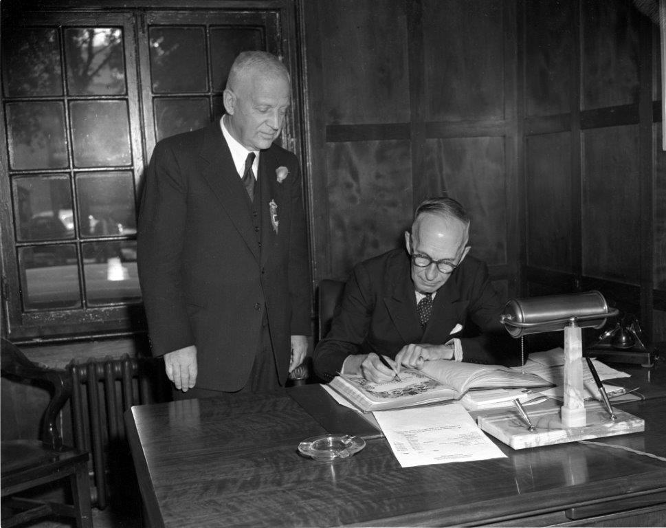 Governor General Vincent Massey Signs The CNE's Opening Ceremonies Book, 1952