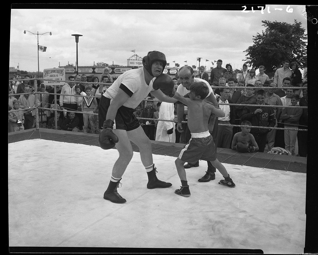 Man Versus Boy In Boxing Match, ca. 1960s
