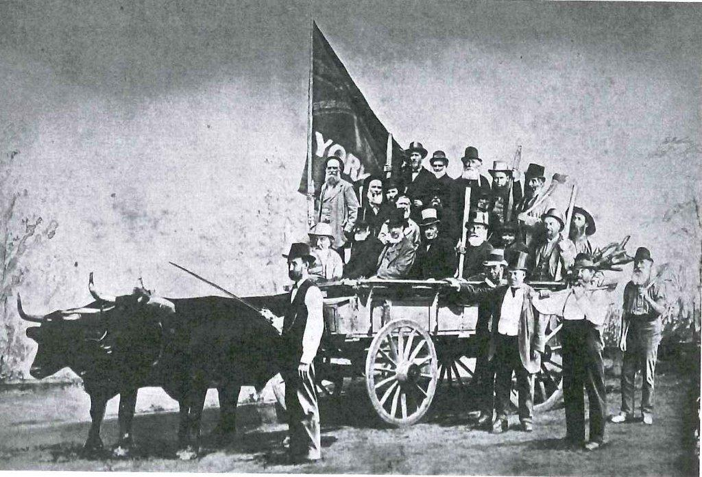 York Pioneers On The Way To Erect Their Log House In Exhibition Park, 1879