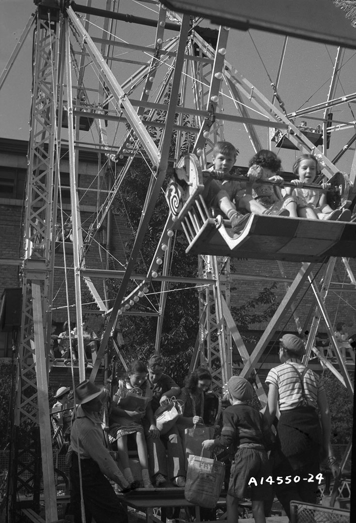 Kids Enjoying The Ferris Wheel, 1940