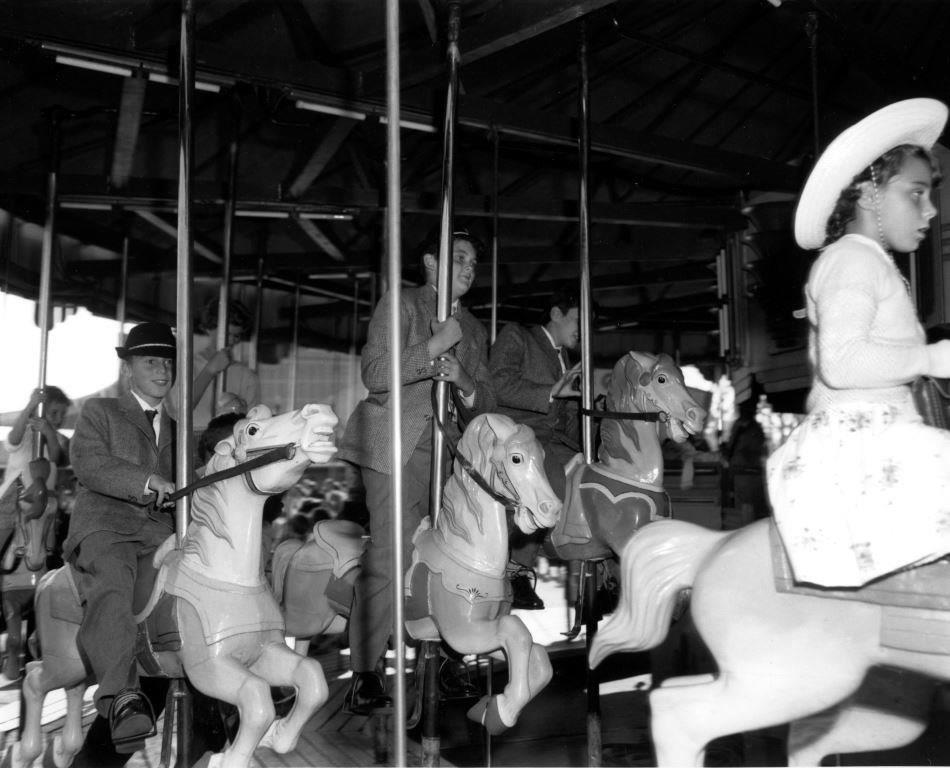 Riding The Merry Go Round, ca. 1950s